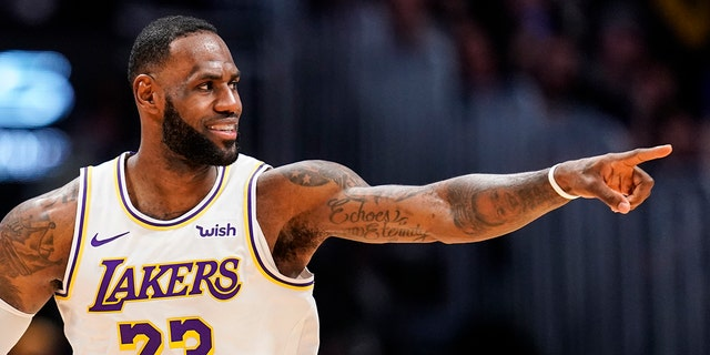 Los Angeles Lakers forward LeBron James was helping the students of his I Promise School in Ohio. (AP Photo/Jack Dempsey)