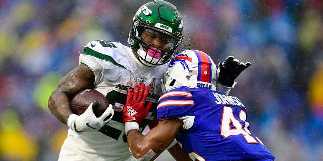 A Buffalo Bills defender tackles New York Jets running back Le'Veon Bell (26) during the first half of an NFL football game Sunday, Dec. 29, 2019 in Orchard Park, N.Y. (AP Photo/David Dermer)