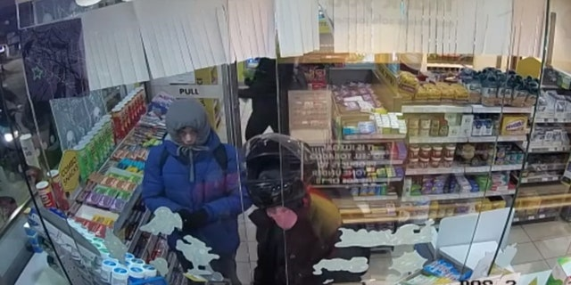 The group of men could be seen stealing items from the gas station.
