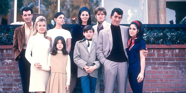 Entertainer Dean Martin with his wife Jeanne and children (Gail, Craig, Claudia, Deana, Gina, Ricci and Dean Paul) pose for a family portrait in 1966 in Los Angeles, California.