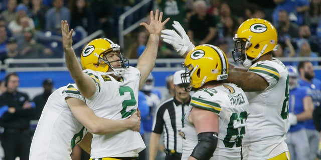 Green Bay Packers kicker Mason Crosby (2) is surrounded by teammates after making the winning field goal during the second half of an NFL football game against the Detroit Lions, Sunday, Dec. 29, 2019, in Detroit. (AP Photo/Duane Burleson)