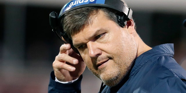 """In this Nov. 28, 2019 photo, Mississippi head coach Matt Luke removes his headset during an NCAA college football game against Mississippi State, in Starkville, Miss. Mississippi has fired Luke, three days after his third non-winning season ended with an excruciating rivalry game loss. Athletic director Keith Carter said Sunday, Dec. 1, 2019 the decision to change coaches was made after evaluating the trajectory of the program and not seeing enough """"momentum on the field."""" (AP Photo/Rogelio V. Solis)"""