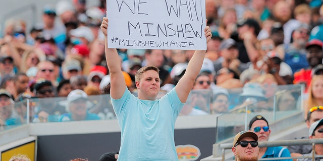 A Jacksonville Jaguars fan holding a sign about Gardner Minshew during the first quarter of a game at TIAA Bank Field on Dec. 1. (Photo by James Gilbert/Getty Images)