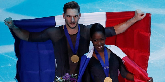 France's Vanessa James and Morgan Cipres celebrate first place in the Pairs Free Skating.