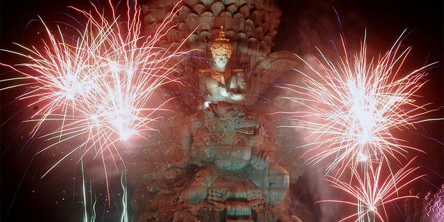 Fireworks explode over Garuda Wisnu Kencana statue during New Year's celebrations in Bali, Indonesia, Jan. 1, 2020. (Reuters)