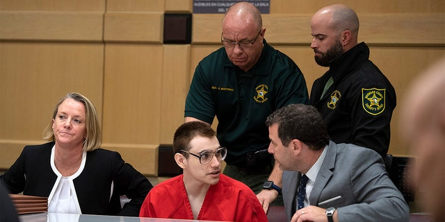 Nikolas Cruz with attorney Gabe Ermine in Judge Elizabeth Scherer's courtroom at the Broward County Courthouse on Dec. 19 in Fort Lauderdale, Fla. (Michael Laughlin/South Florida Sun-Sentinel via AP, Pool)