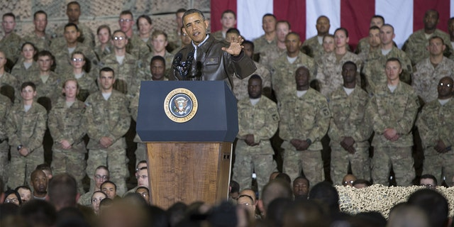 President Barack Obama addresses US troops during a surprise visit to Bagram Air Field, north of Kabul, in Afghanistan, May 25, 2014, prior to the Memorial Day holiday.