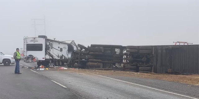 A tractor-trailer jackknifed and rolled over as it crashed into a pileup on Highway 84 in Lubbock County, Texas.
