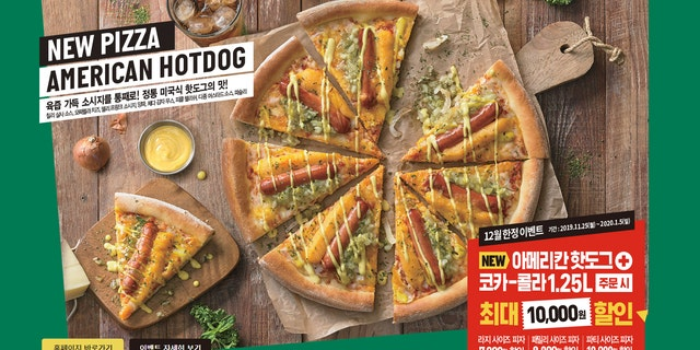 """Available for a limited time, American Hot Dog Pizza comes topped with a whole hot dog on every slice, as well as chili sauce, mozzarella cheese, a cheddar-potato """"mousseline,"""" onions, parsley, relish and mustard sauce."""