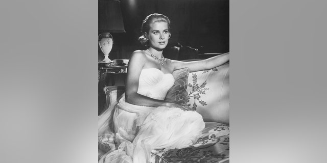 American actress Grace Kelly on the set of 'To Catch a Thief,' directed and produced by Alfred Hitchcock.