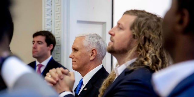 Vice President Mike Pence and Sean Feucht, a worship leader who is running for Congress in California, participate in a faith briefing at the White House complex Friday.