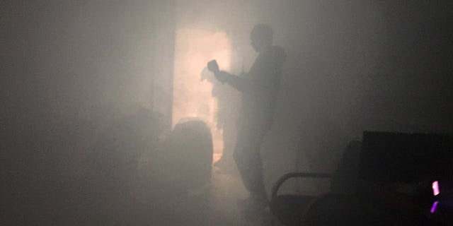 Training exercise at the Foreign Affairs Security Training Center in Blackstone, Virginia. This training is designed to help embassy workers overseas develop the practical skills necessary to operate during an emergency. During the drill, agents must find their way out of a smoke-filled mock embassy.