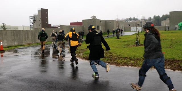 People running during a drill at the Foreign Affairs Security Training Center in Blackstone, Virginia. The newly-opened center is designed to train overseas workers how to respond to security threats and embassy attacks. (Fox News)