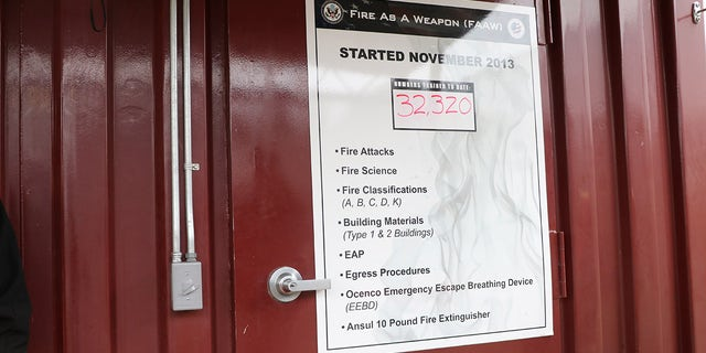 "Sign outside ""Fire as a Weapon"" course at the Foreign Affairs Security Training Center in Blackstone, Virginia. The 1,350-acre compound was designed to train agents following the 2012 Benghazi attacks against two United States government facilities in Benghazi, Libya."