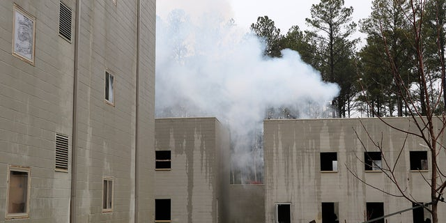 Smoke billowing out of a mock U.S. embassy at the Foreign Affairs Security Training Center in Blackstone, Virginia. The 1,350-acre compound was built to train federal agents how to respond to security threats and attacks around the world. (Fox News/Barnini Chakraborty)