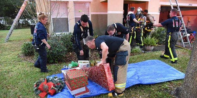 After the blaze was put out, the crew of Polk County Fire's Engine 2 thought they should save the family's Christmas presents.