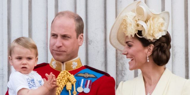 Prince William, Duke of Cambridge with Duchess of Cambridge and Prince Louis on the balcony during Trooping The Colour, the Queen's annual birthday parade, on June 8, 2019, in London, England.