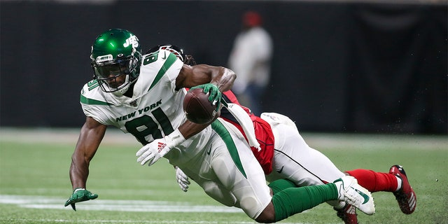 New York Jets wide receiver Quincy Enunwa (81) is tackled by Atlanta Falcons cornerback Desmond Trufant (21) in the second quarter at Mercedes-Benz Stadium.