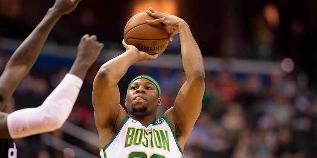 Boston Celtics forward Guerschon Yabusele (30) takes a contested three-point shot during the first quarter against the Washington Wizards at Capital One Arena.