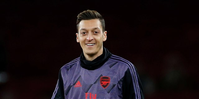 """Soccer Football - Premier League - Arsenal v Brighton & Hove Albion - Emirates Stadium, London, Britain - December 5, 2019 Arsenal's Mesut Ozil during the warm up before the match REUTERS/Eddie Keogh EDITORIAL USE ONLY. No use with unauthorized audio, video, data, fixture lists, club/league logos or """"live"""" services. Online in-match use limited to 75 images, no video emulation. No use in betting, games or single club/league/player publications. Please contact your account representative for further details. - RC27PD9WNC45"""