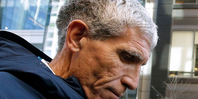 """William """"Rick"""" Singer, founder of the Edge College & Career Network, leaves federal court in Boston after pleading guilty onMarch 12, 2019. (AP Photo/Steven Senne, File)"""