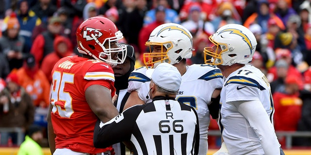 Kansas City Chiefs defensive tackle Chris Jones (95) and Los Angeles Chargers quarterback Philip Rivers (17) arguing during the first half of Sunday's game. (AP Photo/Ed Zurga)
