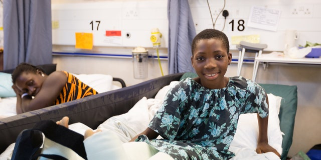 Valerie, pictured recovering after her surgery which took place on board Africa Mercy, said she is excited to see her old classmates again.聽