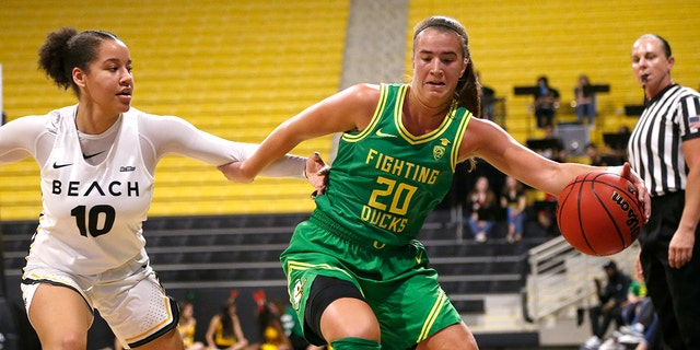 Oregon's Sabrina Ionescu (20) drives against Long Beach State's Justina King (10) in the first half of an NCAA college basketball game, Saturday, Dec. 14, 2094 in Long Beach, Calif. (AP Photo/Ringo H.W. Chiu)