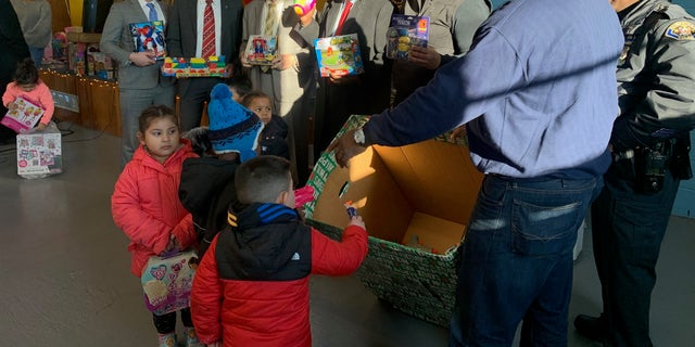 Organizers said Acosta donated the toys for the event.