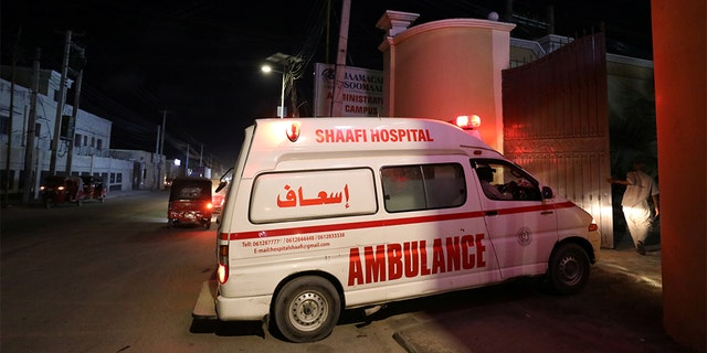 An ambulance carrying an injured person from an attack by Al-Shabab gunmen on a hotel near the presidential residence arrives to the Shaafi hospital in Mogadishu, Somalia December 10, 2019. (REUTERS/Feisal Omar)​​​​​​​