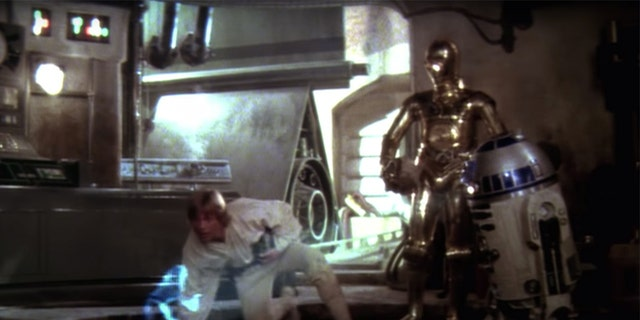 "Luke Skywalker, C-3PO and R2-D2 in ""A New Hope."""