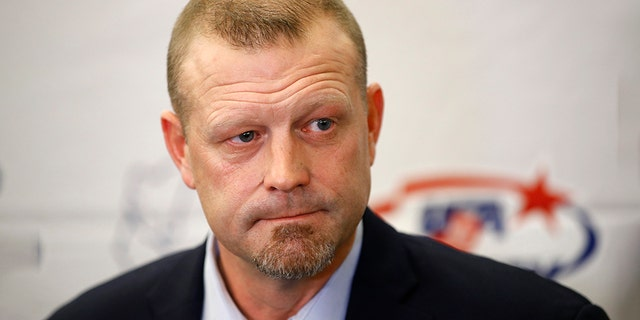 Former Boston Bruins goalie Tim Thomas speaks with members of the media before being inducted into the U.S. Hockey Hall of Fame, Thursday, Dec. 12, 2019, in Washington. (AP Photo/Patrick Semansky)