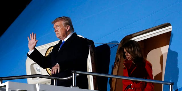 U.S. President Donald Trump waves as he and U.S. first lady Melania Trump arrive at Stansted Airport in England, Monday, Dec. 2, 2019. US President Donald Trump will join other NATO heads of state at Buckingham Palace in London on Tuesday to mark the NATO Alliance's 70th birthday. (AP Photo/Evan Vucci)