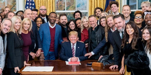 President Trump surrounded by a large group of worship leaders from across the country whom he invited to pray for him in the Oval Office Friday.
