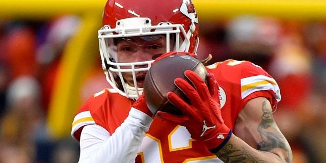 Kansas City Chiefs safety Tyrann Mathieu (32) intercepts a pass intended for Oakland Raiders tight end Darren Waller (83) during the first half of an NFL football game in Kansas City, Mo., Sunday, Dec. 1, 2019. (AP Photo/Ed Zurga)