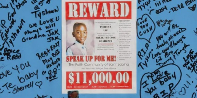 A reward sign and messages hang in November 2015, near where Tyshawn Lee was fatally shot in Chicago.