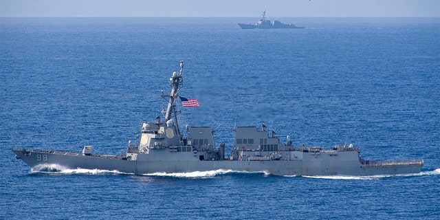 The Arleigh Burke-class guided-missile destroyers USS Forrest Sherman (DDG 98) and USS Farragut (DDG 99) transit the Atlantic Ocean - file photo.