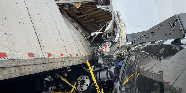 A 34-mile stretch of the interstate was still closed Thursday as crews worked to remove the mangled wrecks.