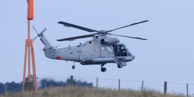 A New Zealand Navy helicopter takes off from Whakatane Airport as the mission to return victims of the White Island eruption begins in Whakatane, New Zealand, Friday, Dec. 13, 2019.