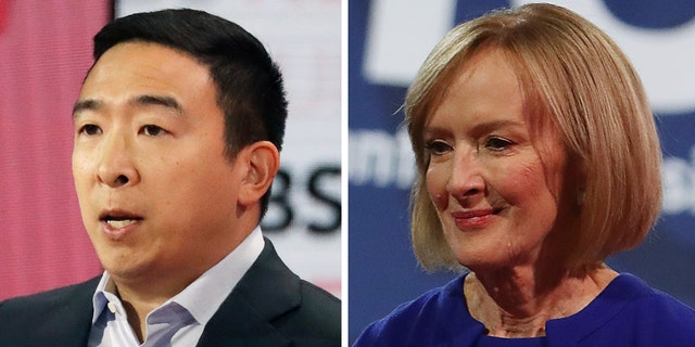 Judy Woodruff had an awkward moment with Andrew Yang, left, soon after the debate got underway. (Justin Sullivan/Getty Images)