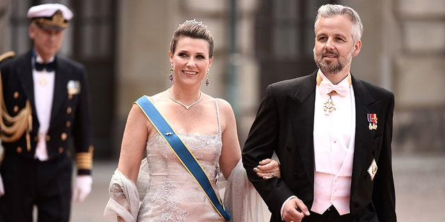 Princess Martha Louise of Norway and her husband Ari Behn attend the royal wedding of Prince Carl Philip of Sweden and Sofia Hellqvist at The Royal Palace on June 13, 2015 in Stockholm, Sweden.