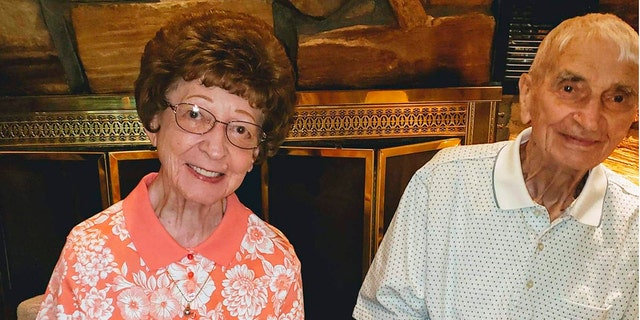 This June 2019 photo provided by Leah Smith shows Les and Freda Austin of Jackson, of Michigan, pose for a photo at a birthday party. The Michigan couple, who family members say did everything together for 70 years up to their final breaths, died 20 minutes apart in the same hospice care on Dec. 6, MLive.com reports. (Leah Smith via AP)