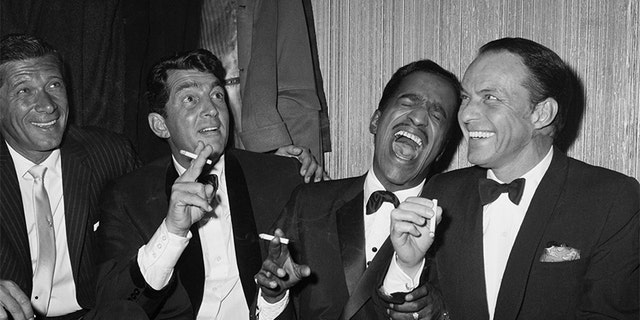 Jan Murray (L) sits alongside Rat Pack members Dean Martin, Sammy Davis Jr., and Frank Sinatra as the group unwinds backstage at Carnegie Hall after entertaining at a benefit performance in honor of Dr. Martin Luther King Jr.