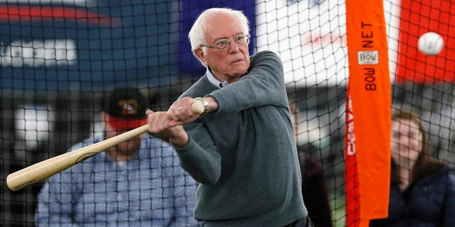 Democratic presidential candidate Sen. Bernie Sanders, I-Vt., hits in the batting cage during a meeting with minor league baseball players and officials at FunCity Turf, Sunday, Dec. 15, 2019, in Burlington, Iowa. (AP Photo/Charlie Neibergall)