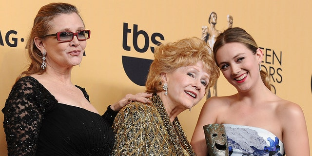 Carrie Fisher, Debbie Reynolds and Billie Lourd pose in the press room at the 21st annual Screen Actors Guild Awards at The Shrine Auditorium on Jan. 25, 2015, in Los Angeles, Calif.