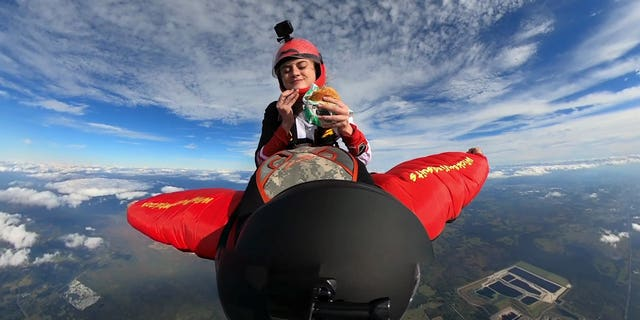 McKenna Knipe, 24, was filmed testing the Burger King Impossible Whopper using a GoPro while she was skydiving.