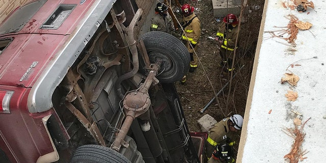 The vehicle fell about 25 feet after it was driven off the top of the parking deck.