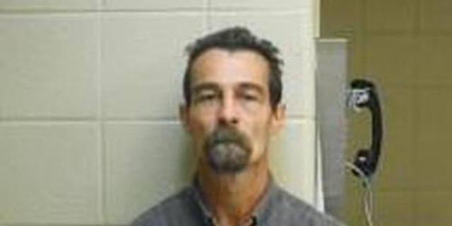 Frankie Carmody, 47, faces charges of first-degree false imprisonment, possession of a controlled substance, possession of firearms by certain persons and furnishing, possessing or using prohibited articles, authorities say. (Clark County Sheriff)