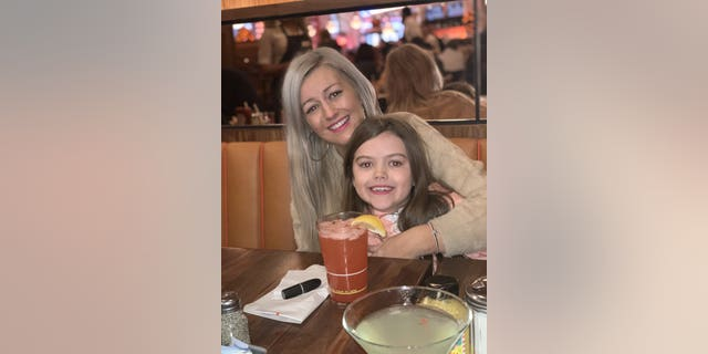 Jennifer Bell, 28, with daughter Georgia, eight. Terminally ill mother Jennifer Bell, 28, who was diagnosed with motor neuron disease in March, says she feels blessed to be able to spend Christmas with her children -- despite knowing it may be her last.
