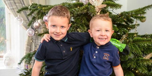 Jacob Scrimshaw, 5, hugging his younger brother Sebastian, 3.
